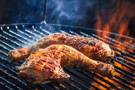 Roast chicken leg on grill photo