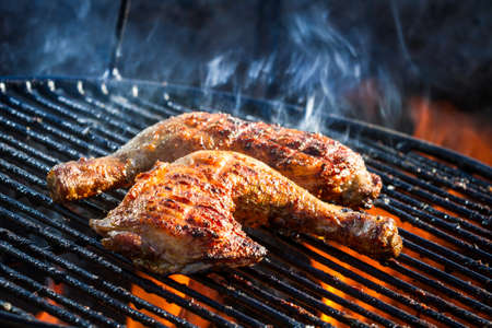 chicken leg: Flames frying chicken on the grill