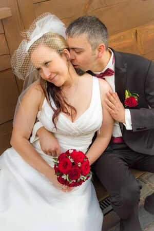 Just married young couple sitting on the porch and kissing Stock Photo - 14119202