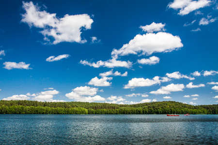 Canoe trip on the lake in summer photo