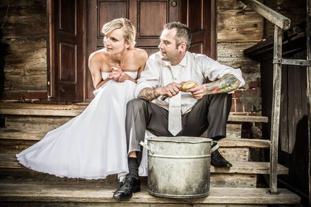 Young couple on the porch peeling potatoes Stock Photo - 14443052
