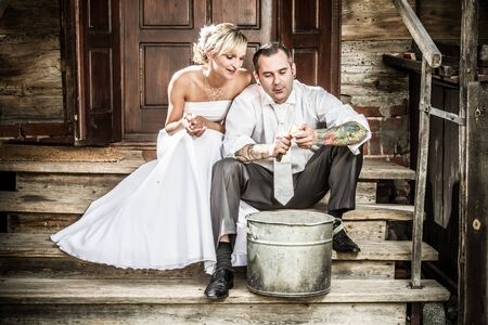 Young couple takes potatoes for wedding ceremonies Stock Photo - 14443059
