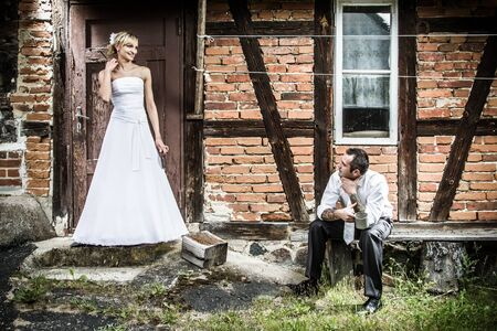 Young couple in front of the old house in the countryside Stock Photo - 14443043