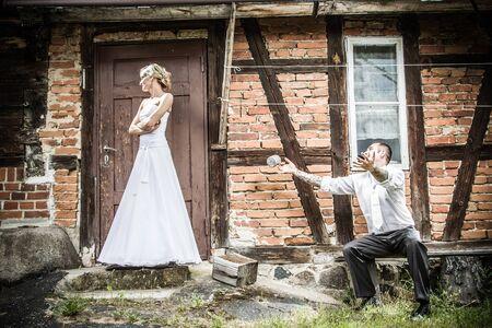 The groom bride apologizes Stock Photo - 14443064