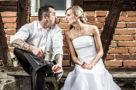 Young couple doing silly faces to each other Stock Photo - 14442994