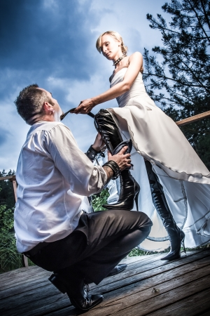 fetish wear: Eccentric wedding young couple Stock Photo