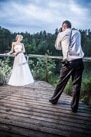 Bride and groom photo session in the park by the lake Stock Photo - 14443053