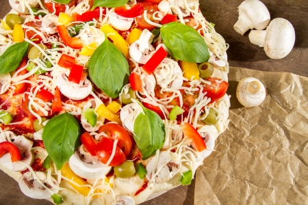 Close-up of pizzas made with fresh vegetables photo