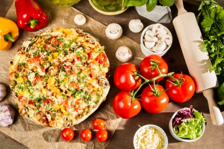 Baked pizza and ingredients photo