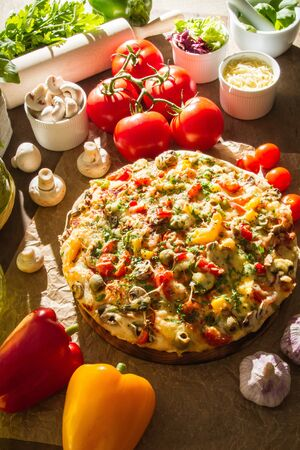 Pizza and fresh tomatoes with other vegetables Stock Photo - 14727590