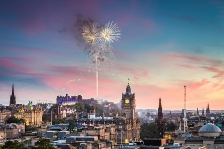Fireworks over Edinburgh Castle at sunset