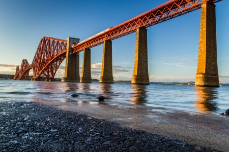 forth: Train riding on the Forth Road Bridge at sunset