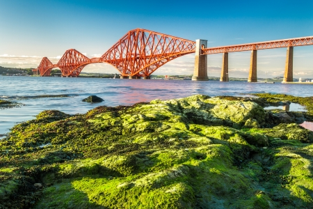 Coast at low tide near the Firth of Forth Bridge in Scotland photo