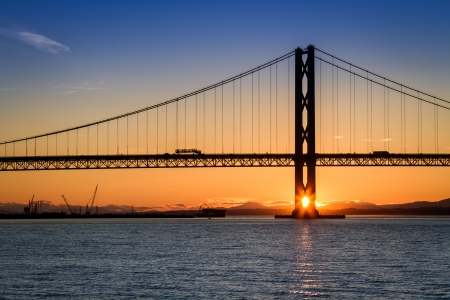 Sunset over the Forth Road Bridge in Scotland photo