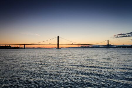 Sunset over river and bridges in Queensferry photo