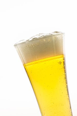 Glass of light beer on white background photo