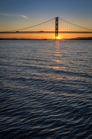 Sunset over the Forth Road Bridge in Edinburgh photo