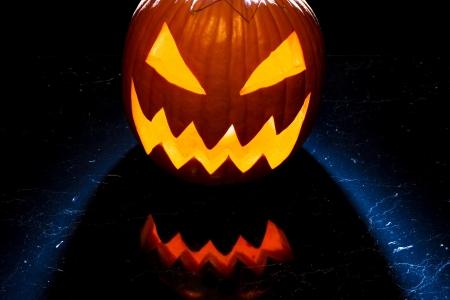 jack o latern: Glowing halloween pumpkin on the marble table