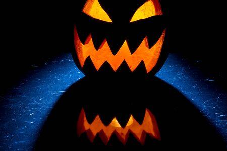 jack o latern: Pumpkin glowing on Halloween Stock Photo
