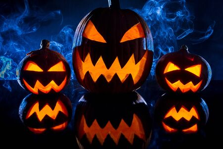 Three smoking pumpkins for Halloween celebration photo