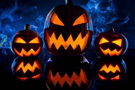 jack o latern: Three smoking pumpkins for Halloween celebration