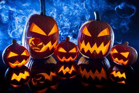 jack o latern: Smoking group Halloween pumpkins Stock Photo