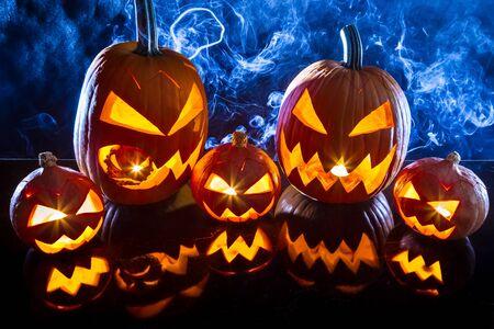 jack o latern: Group halloween pumpkins on the background smoke Stock Photo