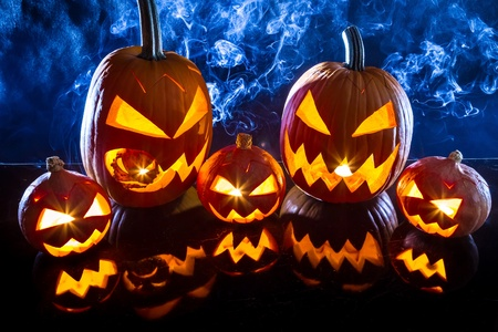 spook: Smoking group Halloween pumpkins on marble table