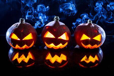 jack o latern: Three small smoking pumpkins for Halloween Stock Photo