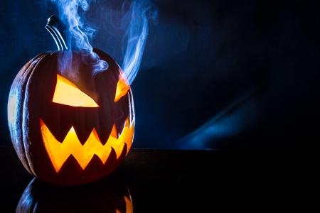 jack o latern: Smoking halloween pumpkin head