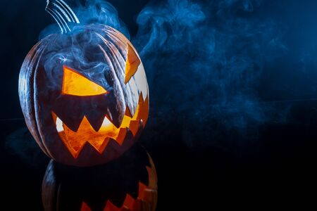 jack o latern: Smoking scary halloween pumpkin head