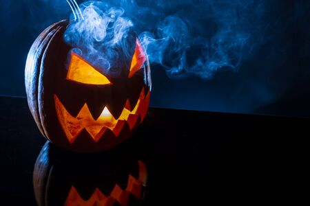 jack o latern: Smoke rising from the pumpkin for halloween