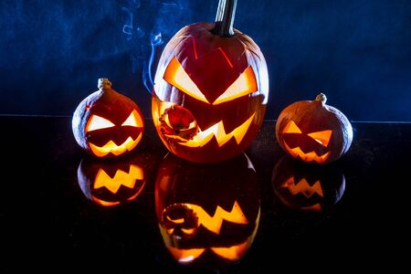 jack o latern: Pumpkins, smoke and black background for halloween holiday Stock Photo