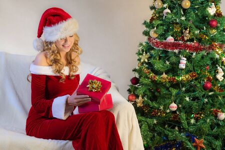 christmas eve: Christmas eve with beautiful woman in red Stock Photo