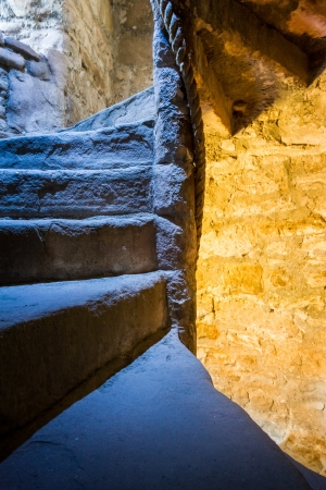 Stone Spiral Stairway in the Castle Stock Photo - 15324527