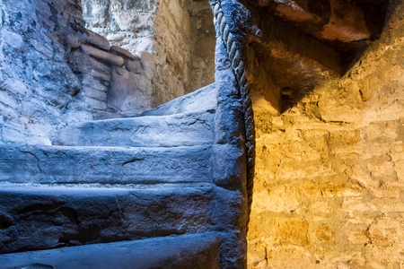 Lighted stone staircase in a medieval castle photo