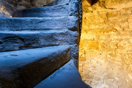 Lighted stone staircase in a Scotland castle photo