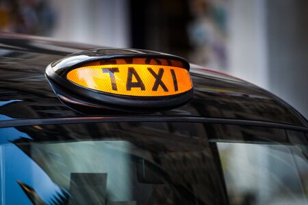 a yellow taxi: Taxi sign in UK