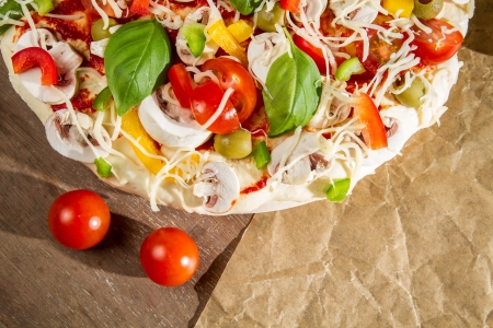 Close-up of fresh pizza  on the baking paper Stock Photo