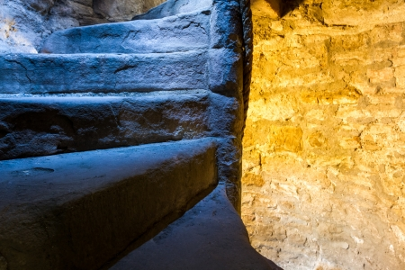 From cold to warm light in stone staircase photo
