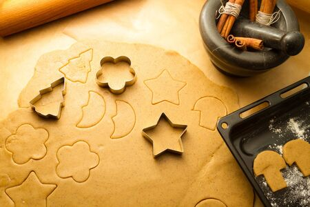 Cutting Christmas cookies made of gingerbread photo