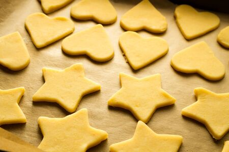 Christmas cookies on a baking tray to bake Stock Photo - 15963383