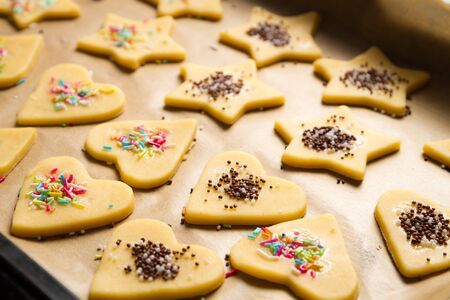 Decorated Christmas cookies ready for baking Stock Photo - 15963371