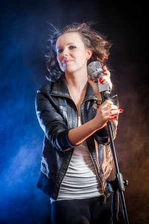 Smiling young woman on the stage photo