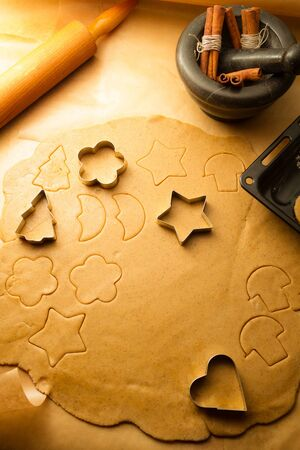 Cutting Christmas cookies made from gingerbread Stock Photo - 16272254