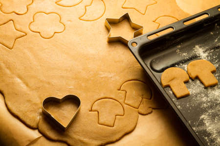Closeup cutting of homemade gingerbread cookies photo