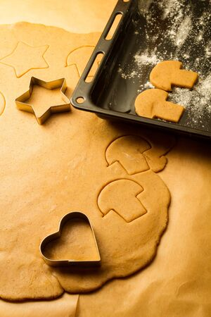Cutting of homemade gingerbread cookies photo
