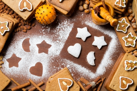 Christmas gingerbread frame surrounded by nuts Stock Photo - 16397565