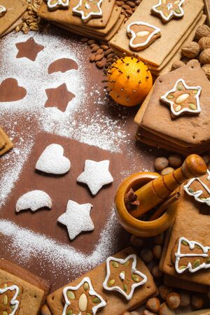 Decorating cookies surrounded by nuts and gingerbread Stock Photo - 16397547
