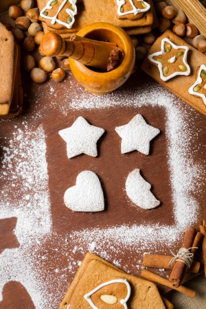 Gingerbread cookies decorated with icing sugar photo